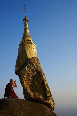 Buddhist Monk Praying at the Golden Rock of Nwa La Bo