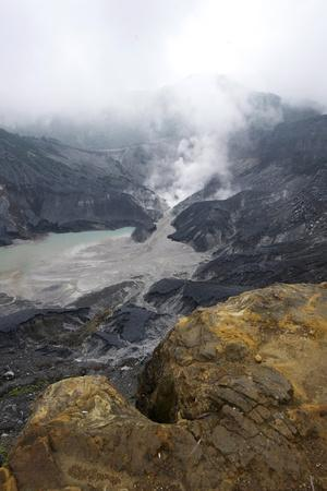 Hot Volcanic Steam Rising into Monsoon Clouds from Kawah Ratu (Queen's Crater) of Mount Tangkuban