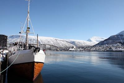 Whaler in Tromso Harbour with the Bridge and Cathedral in Background