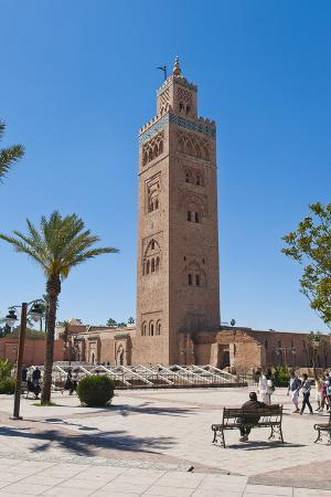 Moroccan Man Sat on a Bench in Front of Koutoubia Mosque, Marrakech, Morocco, North Africa, Africa