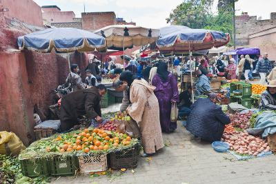 Moroccan People Buying and Selling Fresh Fruit in the Fruit Market in the Old Medina