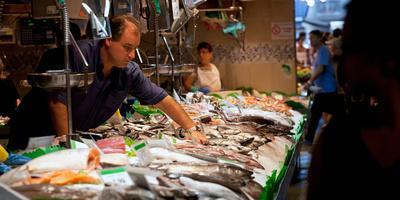 Fishmonger at a Fish Stall, La Boqueria Market, Ciutat Vella, Barcelona, Catalonia, Spain
