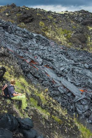 Man Watching an Active Lava Stream, Tolbachik Volcano, Kamchatka, Russia, Eurasia