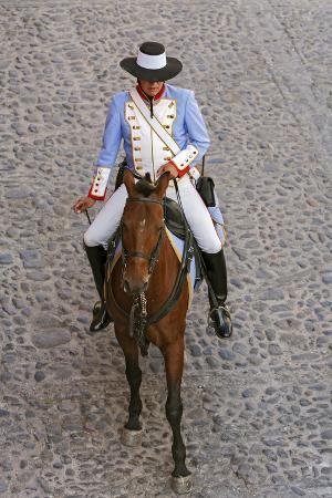 A Mounted Tourist Policeman Wearing 19th Century Uniform