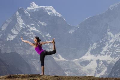 A Woman Practices the Lord of the Dance Pose or Natarajasana