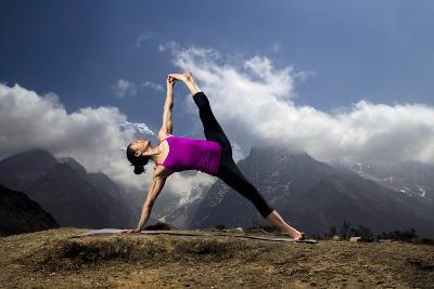 A Woman Practices a Side Plank Pose or Vasisthasana in Phortse