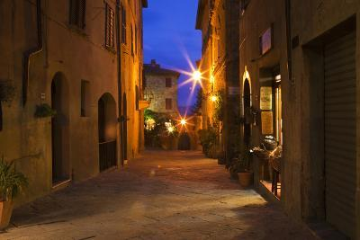 Main Street of Pienza with evening Blue Light and Street Lights.