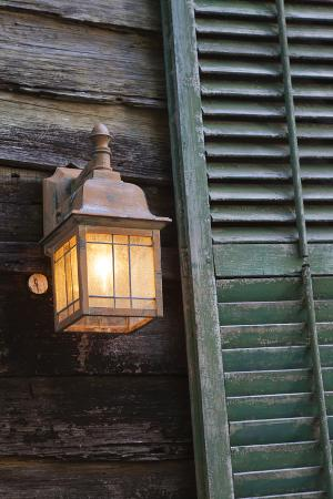 USA, Florida, St. Augustine, Shutter and lantern on old house.