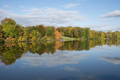 New York, Erie Canal. Fall reflections on the Oswego Canal.