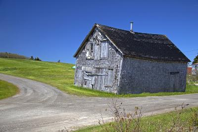 Canada, Nova Scotia. Aged barn at a forked road.
