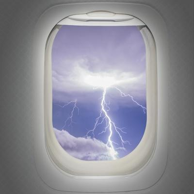 Aircraft Window with View of Lightning Strike