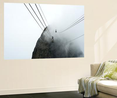 An Image Of A Cable Car Through The Mist