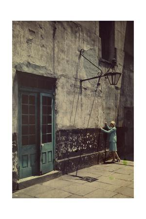 A Woman Touches the Wall of the Municipal Building for the Cabildo