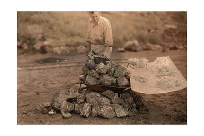 A Man Examines the Mineral Yielded from South Africa's Rocks