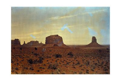 A Sunlit View of Monument Valley, Rises Up on the Utah-Arizona Border