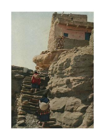 Two Women Climb the Stairs of an Acoma Pueblo