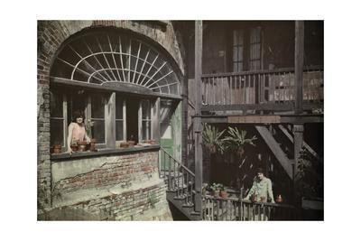 Women Peer Out of their Windows and Balconies in the French Quarter