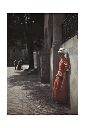A Woman Leans Against a Wall in the Spitalhof