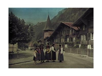 A Group of Mothers and Daughters Pose on a Village Street Corner