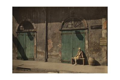 A Woman Sits Outside the Doorway of New Orlean's Absinthe House