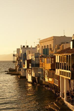 Golden Sunlight on the Little Venice Neighborhood on the Coast of the Aegean Sea