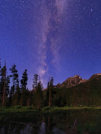 The Milky Way in the Morning Twilight over the Teton Range and a Scenic Forest Lake
