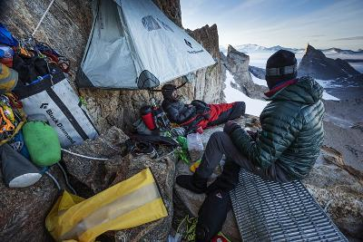 Expedition Team Members Try to Stay Warm on a Ledge of Bertha's Tower,1,200 Feet Above the Ground