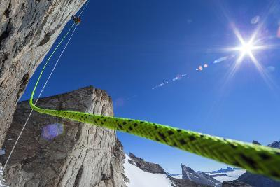 A Mountaineer Ascends a Fixed Rope on the Final Summit Push of Bertha's Tower, a 2,000-Foot Spire