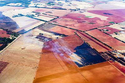 Smoke Rises from Agricultural Crops Being Burned on a Vast Plain of Arid Farmland