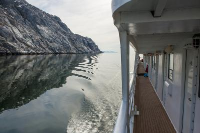 A Cruise Ship Passing a Rocky Coast in the Waters of Glacier Bay National Park
