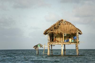 A Couple Sit in their Traditional Bajo Home on the Outskirts of Sampela