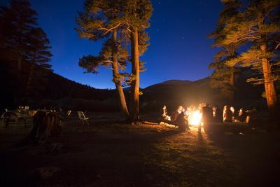 Campers Gather around a Campfire