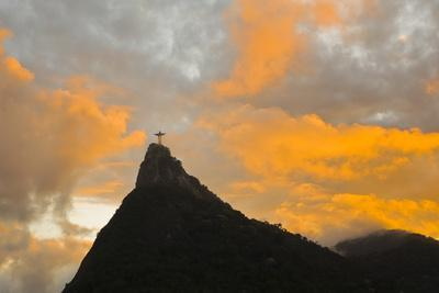 The Christo Redentor Statue before an Intense Orange Glow at Sunset
