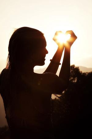A Woman Captures the Sun in Her Hands
