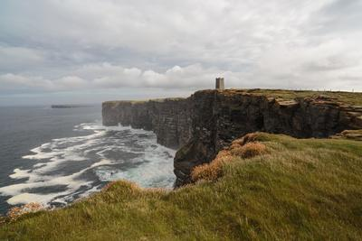 The Storm Tossed Cliffs of Marwick Head with the Lord Kitchener Memorial