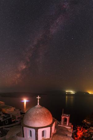 The Milky Way and the Summer Triangle over the Aegean. Boat Lights and City Lights Cast Reflections