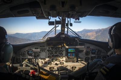 A View from Inside the Cockpit of a Twin Otter Plane Taking Off from Lukla Airport in Nepal