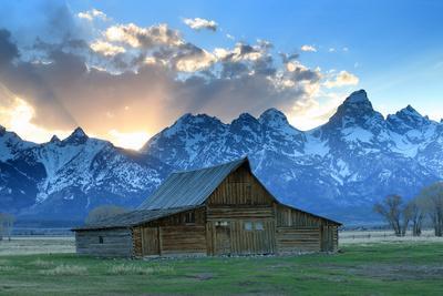 At Sunset, the Teton Range Rises Behind a Historic Barn on Mormon Row