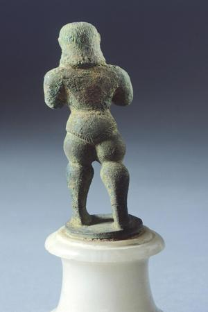Bronze Statue Depicting Armed Figure Making Offering, Rear View, 625-600 BC