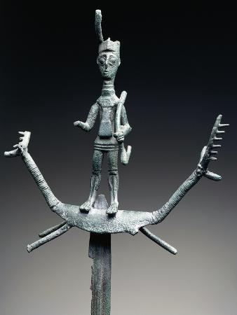 Archer Wearing Horned Hat Placed on Votive Sword, Surmounted on Deer-Shaped Protomes