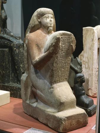 Gres Statue of Nefferenpet Holding Stele