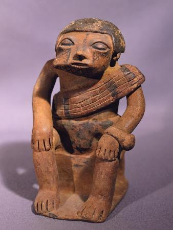 Pottery Statue Depicting a Figure Chewing Coca, Artifact Originating from Colombia