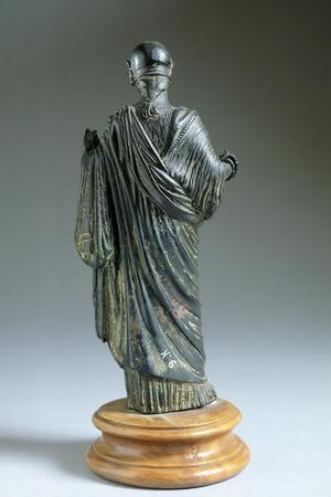 Bronze Statue Depicting Woman Wearing a Toga, Rear View. Etruscan Civilization, 7th Century BC