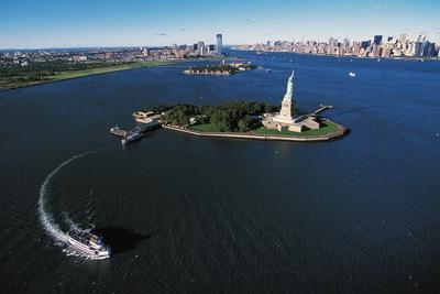 Liberty Island with Ellis Island and Manhattan in the Background, New York, United States.
