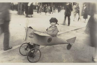 Boy in a Toy Aircraft