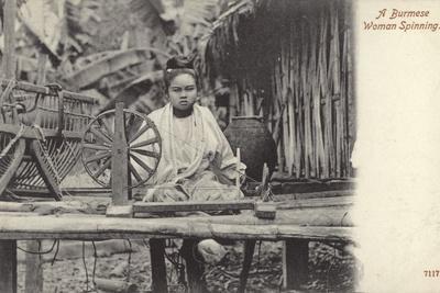 A Burmese Woman Spinning