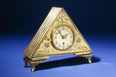 A Triangular Brass Table Clock with Engraved Floral Decoration