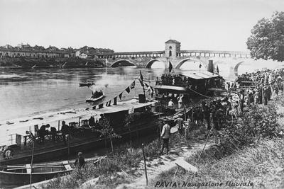 Italy, Pavia, Waterway Transportation on Ticino River with Ponte Coperto