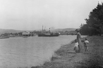 Woman and Children Watching a Ship at Waipu Wharf, C.1900