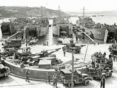 Trucks, Jeeps and Heavy Equipment are Loaded on Four Landing Ships, Tank